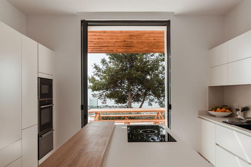 arquitectura vivienda entrepinares cocina es isla