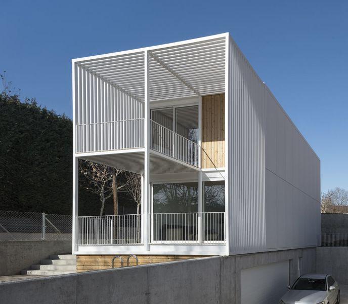 arquitectura BXD Arquitectura casa MG fotografía Alejo Bagué fachada garaje