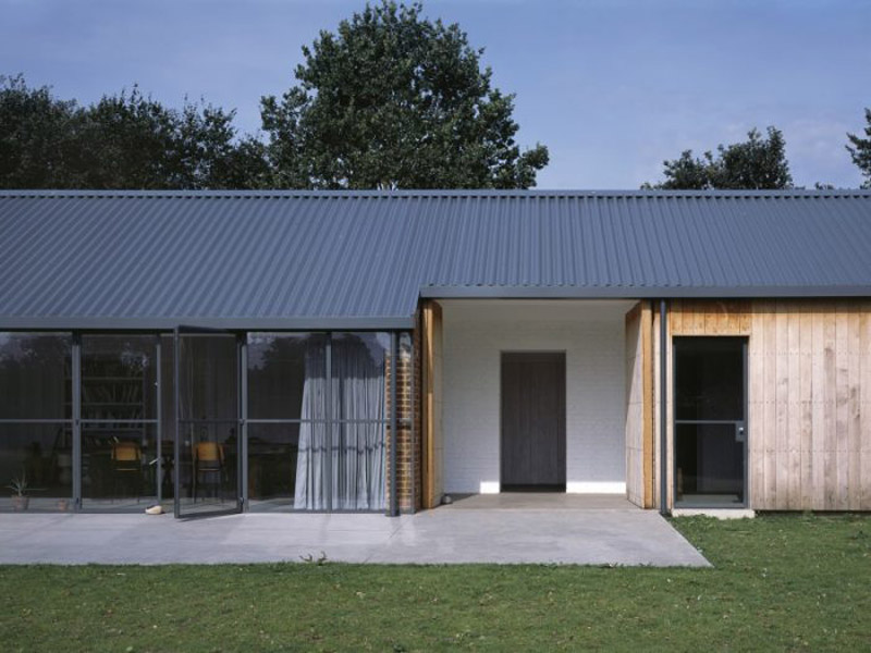 Arquitectura_stable-acre-david-kohn-architects-exterior apertura de cerramiento tipo granero