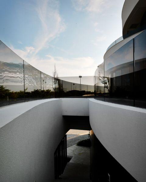 Edificio comunitario - arquitectura_y_empresa_Green Places Community Clubhouse_revestimiento continuo