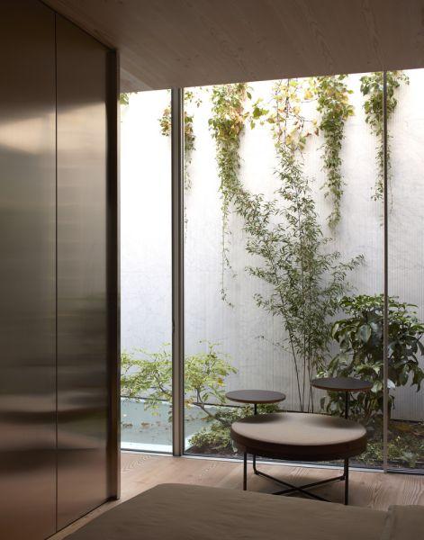 arquitectura y empresa_House_in_a_garden_patio inglés dormitorio