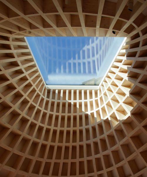 arquitectura y empresa_House_in_a_garden_techo madera