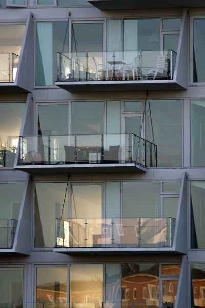 la ola _henning-larsen-architects_ vista de balcones acristalados y terrazas