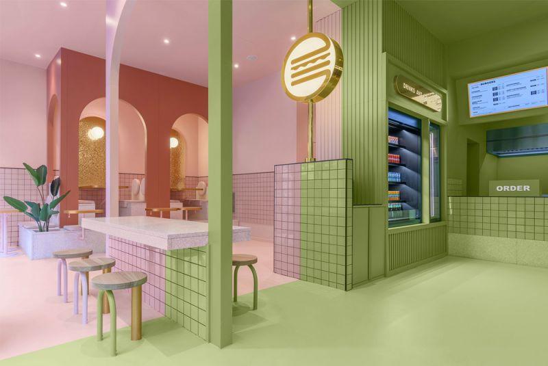 Imagen de detalle del interior en verde la zona pedidos y en rosa comedor