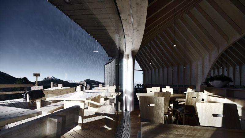 Imagen del bar del refugio y la terraza panorámica exterior