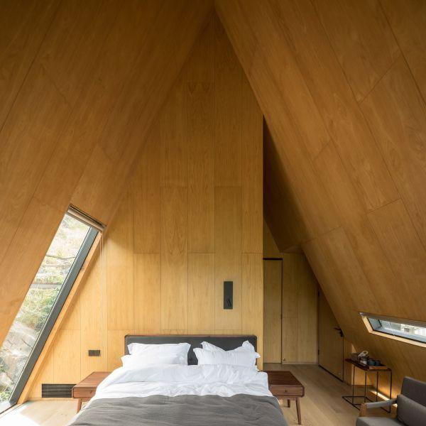 arquitectura y empresa_woodhouse hotel_cabañas int
