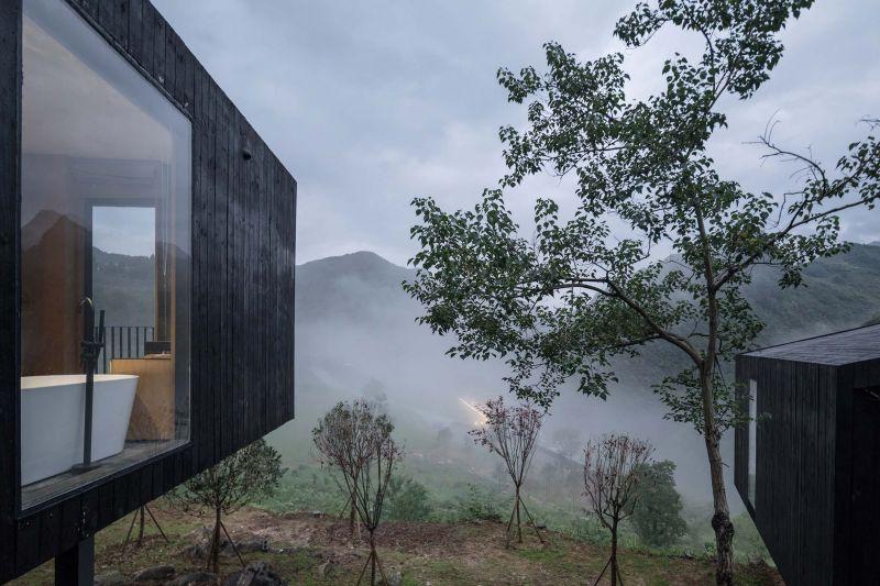 arquitectura y empresa_woodhouse hotel_cabañas vistas