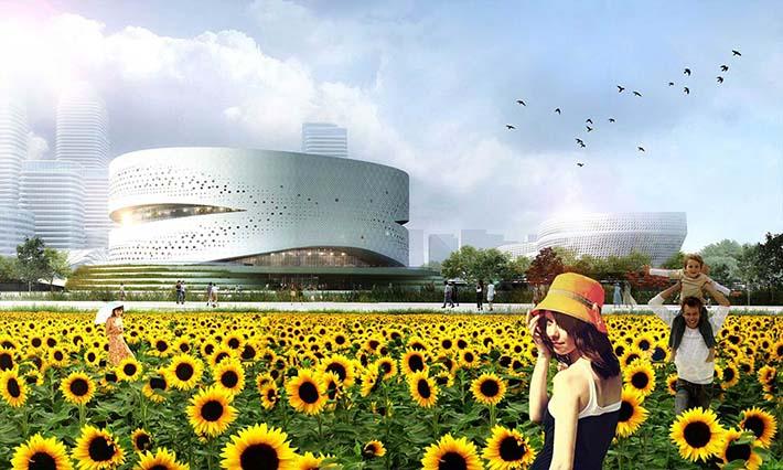 Edificio de Binhai Eco city al fondo de un campo de girasoles
