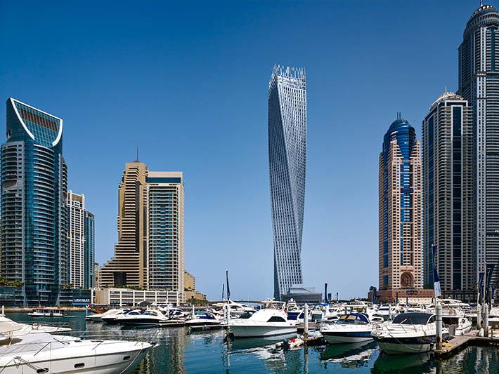 esta torre supone un icono distintivo en el skyline de dubai al mismo tiempo llamativo y sutil la cayan tower es un edificio residencial que sigue la idea