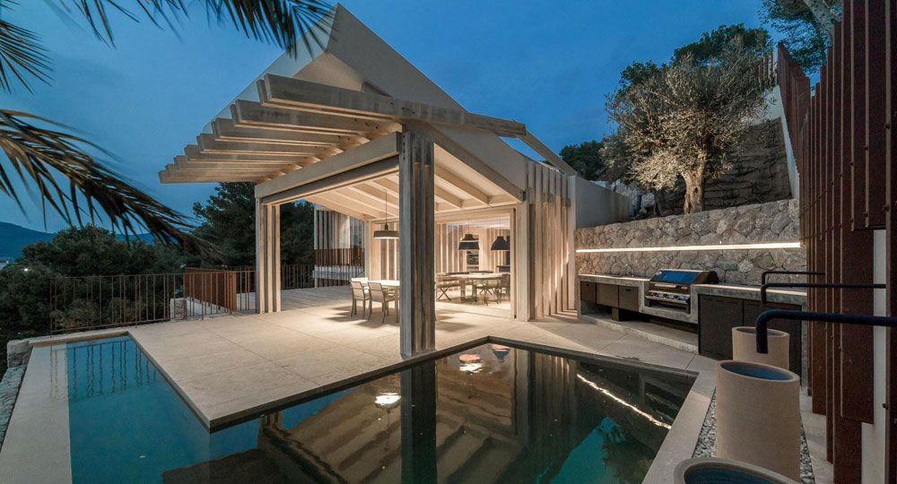 Arquitectura, madera, piedra y cristal