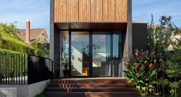 Open Shut House: ampliación de vivienda y contrastes arquitectónicos